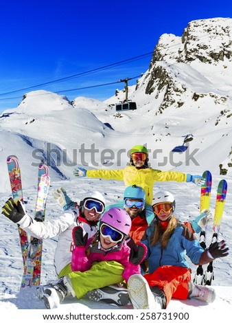 Ski, winter, snow - family enjoying winter vacation in Verbier, photo manipulation: Only four model releases are needed - the same child on the photo. - stock photo
