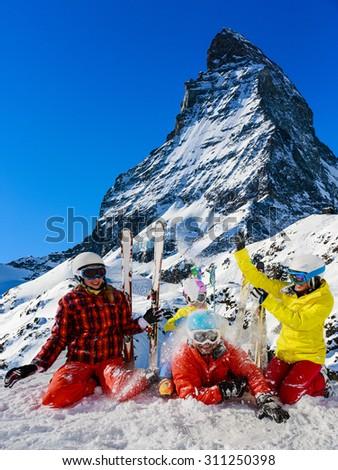 Ski, winter, snow - family enjoying winter vacation in Zermatt, Switzerland - stock photo