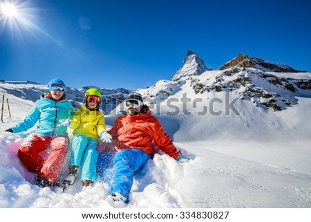 Ski, winter, snow - family enjoying winter vacation in Zermatt, Switzerland