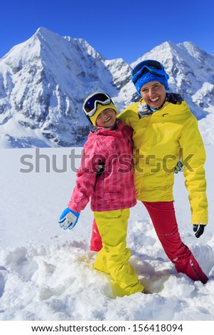 Ski, winter, snow, skier, sun and fun - family enjoying winter vacations - stock photo