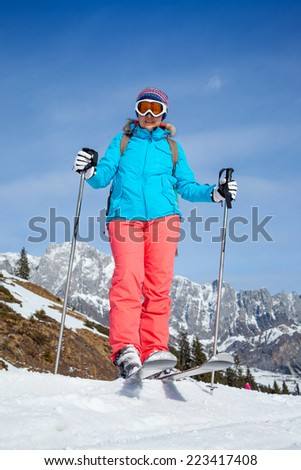Ski, winter, snow, skiers, sun and fun - Middle Aged Woman On Ski Holiday In Mountains