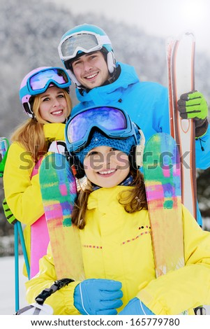 Ski, winter, snow, skiers, sun and fun - young skiers enjoying winter holidays - stock photo