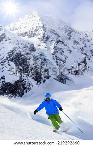 Ski, winter sport - freeride in fresh powder snow  - stock photo