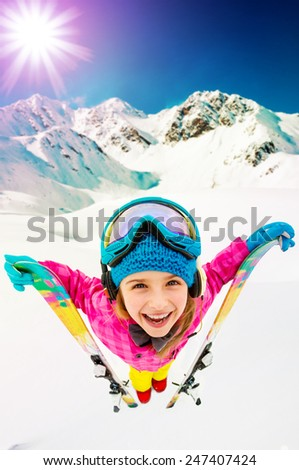 Ski, winter vacation, snow, skier, sun and fun - girl enjoying ski vacations, filtered - stock photo