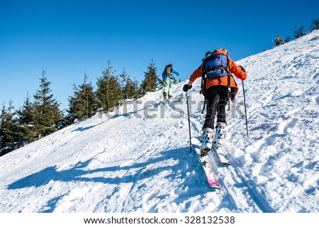 skialpinists on a snowy slope