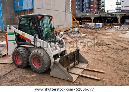 Skid loader on construction site - stock photo