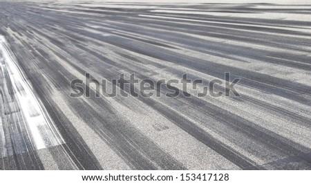 Skid marks on asphalt - stock photo