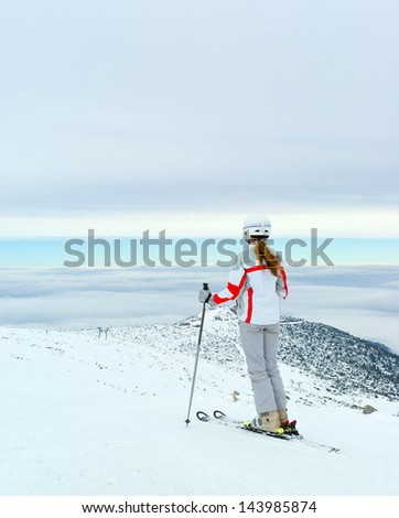 Skier admire on beautiful view from top of mountain Pirin. Bansko. Bulgaria. - stock photo
