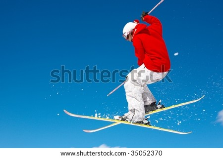 Skier and a blue sky - stock photo