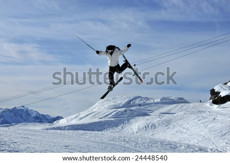Skier  appearing to conduct an orchestra with his stick while flying through the air