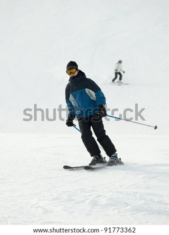 Skier coming down the slope - stock photo