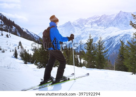 Skier enjoying beautiful view of alps mountains near chamonix, france