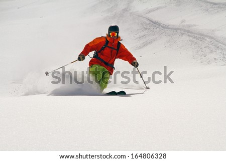 Skier in deep powder, extreme freeride - stock photo