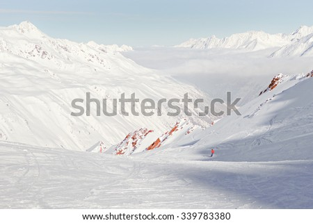 skier in red jacket in the European Alps - stock photo