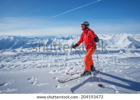 Skier is posing at camera at Gudauri resort in high mountaing of Georgia, Caucasus