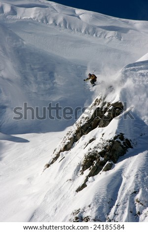 Skier jump from big rock
