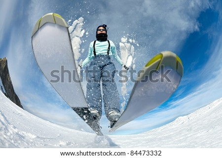 Skier jumping on the slope - stock photo