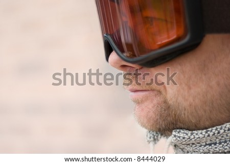 Skier looking through goggles.