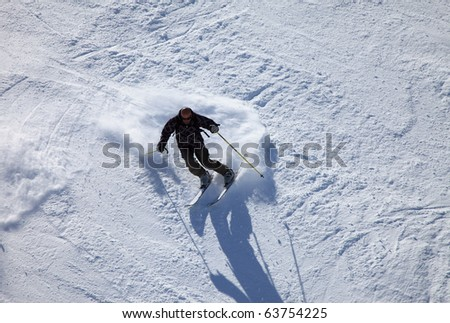 Skier (mature man on 40s) seen from above