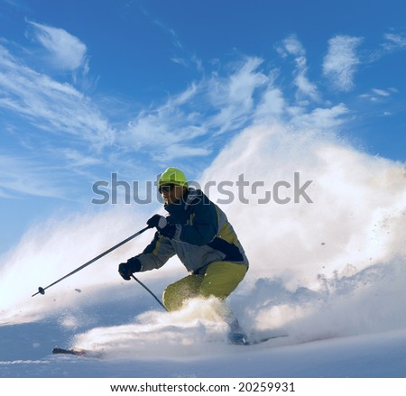 skier moving down on ski slope