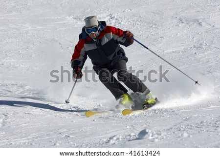 skier moving down on the snow slope