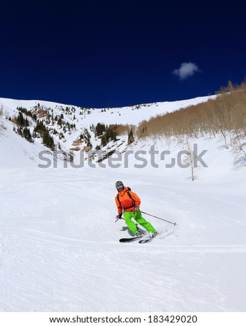 Skier on a sunny day in the Utah mountains, USA. - stock photo