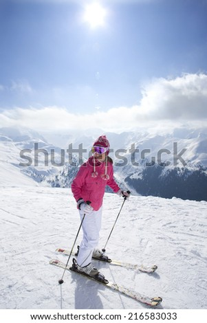 Skier on mountain top looking at mountains