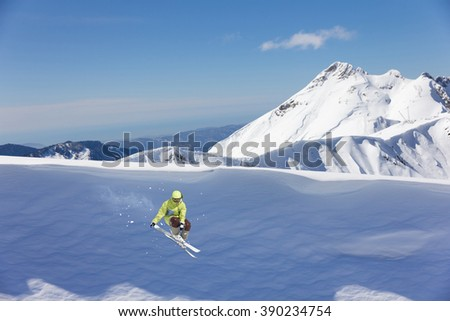 Skier on mountains, extreme jump. Winter sport.