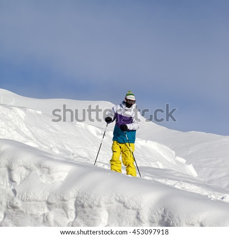 Skier on off-piste slope in sun day - stock photo