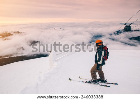 Skier on piste in high mountains above the clouds, Europe, Slovakia, Chopok, Jasna - stock photo