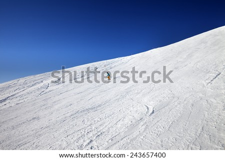 Skier on slope in sun day. Caucasus Mountains, Georgia, ski resort Gudauri.  - stock photo
