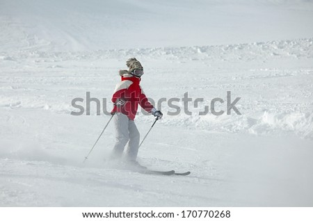 Skier on the slope - stock photo