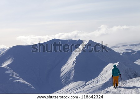 Skier on top of mountain. Caucasus Mountains, Georgia, ski resort Gudauri. - stock photo