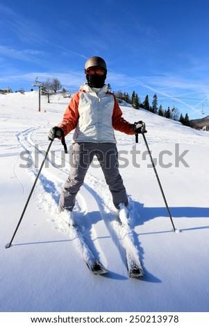 Skier on winter ski resort - stock photo