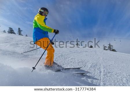 skier powder, mountain peak colors - stock photo