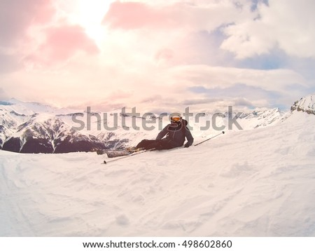 Skier sitting on the mountain in the snow