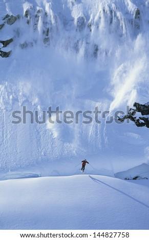 Skier skiing in mountain - stock photo