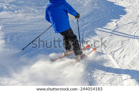 skier slipping on the ski slope
