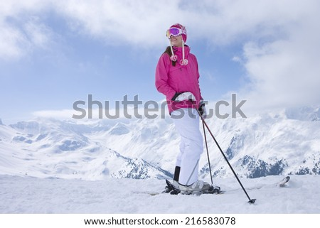 Skier stopping on mountain top looking at mountains