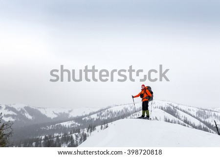 skier with a backpack on top of the hill in Ural mountains one