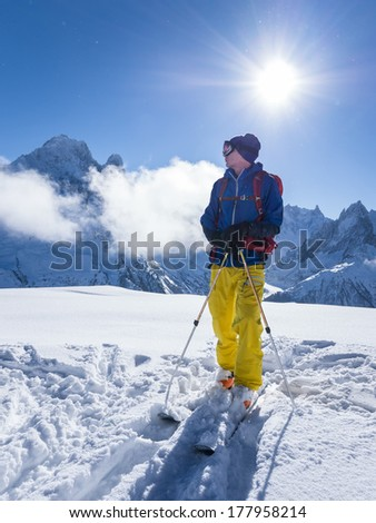 Skier with sun in background in Chamonix