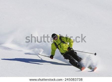Skier with white snow background. - stock photo