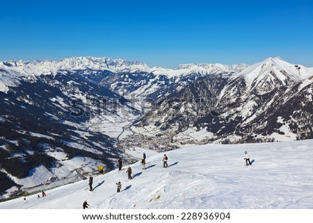 Skiers at mountains ski resort Bad Gastein Austria - nature and sport background - stock photo