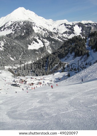Skiers descend to tiny mountain village near   Chatel,French Alps, France