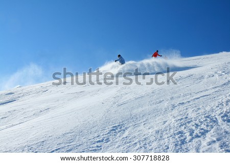 Skiers in deep powder, extreme freeride - stock photo