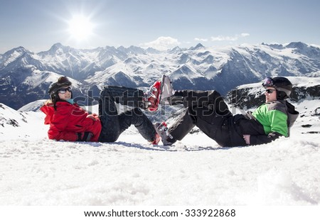 Skiers lying on snow in high mountains without ski, Alps France - stock photo