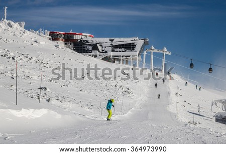 Skiers on ski runs in the Tartas, Slovakia - stock photo