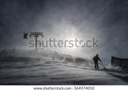 Skiers on ski runs in the Tatras, Slovakia in wintertime - stock photo