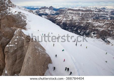 Skiers on the Marmolada mountain peak, Tirol, Alps - stock photo