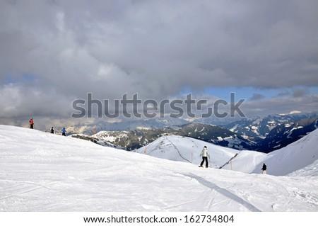 Skiers on the slope in Saalbach ski resort, Austrian Alps - stock photo